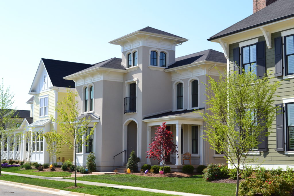 Image of townhomes from a road perspective.